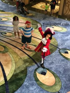 Captain Hook and Mr. Smee telling guests to walk the plank on the Disney Fantasy. TravelAMM.com