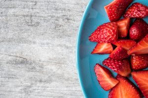 Plate of sliced strawberries.